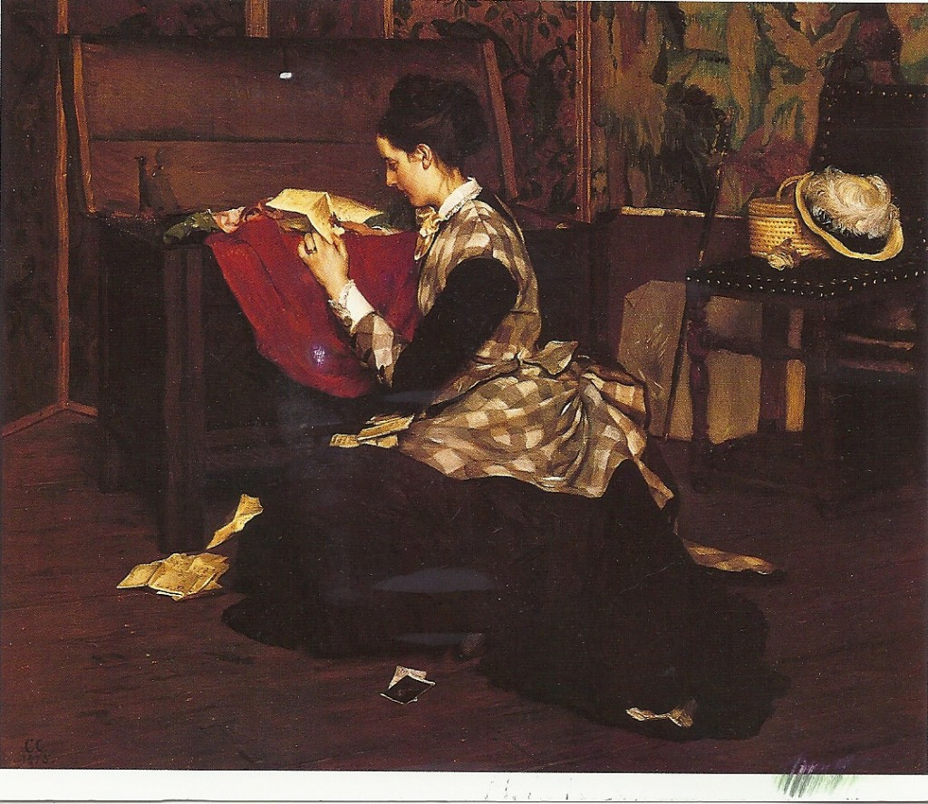woman reading a letter from a trunk
