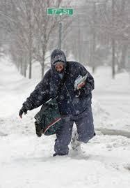 lettercarrier walking in snow